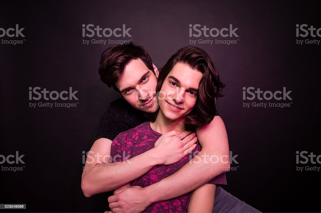 Cute young gay male couple. stock photo