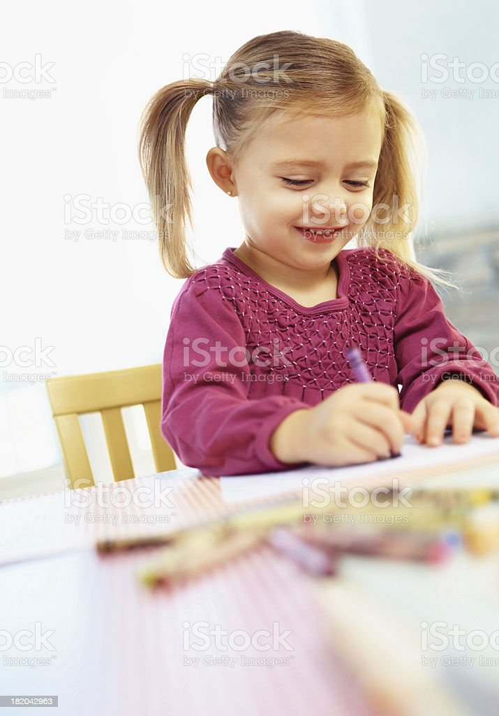 Cute young girl doing her home work royalty-free stock photo