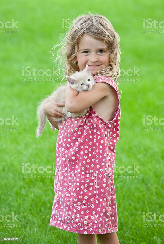 Cute Young Girl Holding Kitten royalty-free stock photo