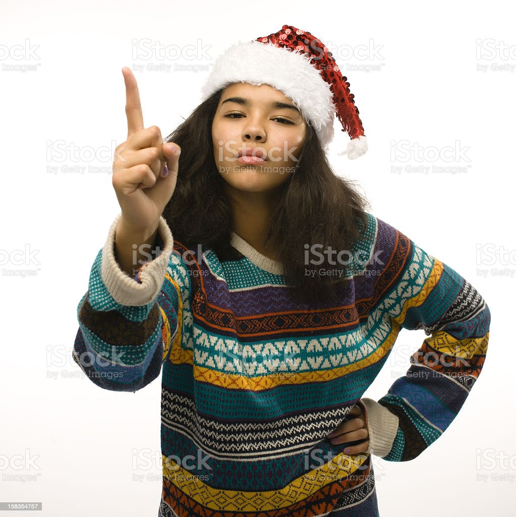 cute young girl in santas red hat isolated royalty-free stock photo