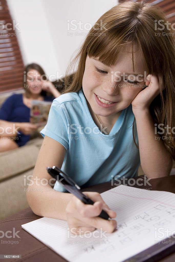 Cute Young Girl Practicing Alphabet at Home royalty-free stock photo
