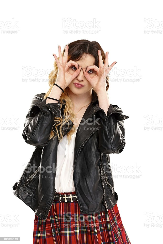 Cute young girl pretending to wear glasses royalty-free stock photo