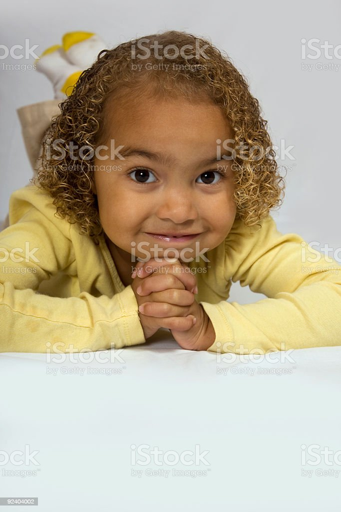 cute young girl resting on floor stock photo