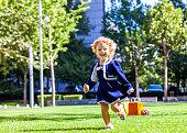 Cute young girl running in the yard