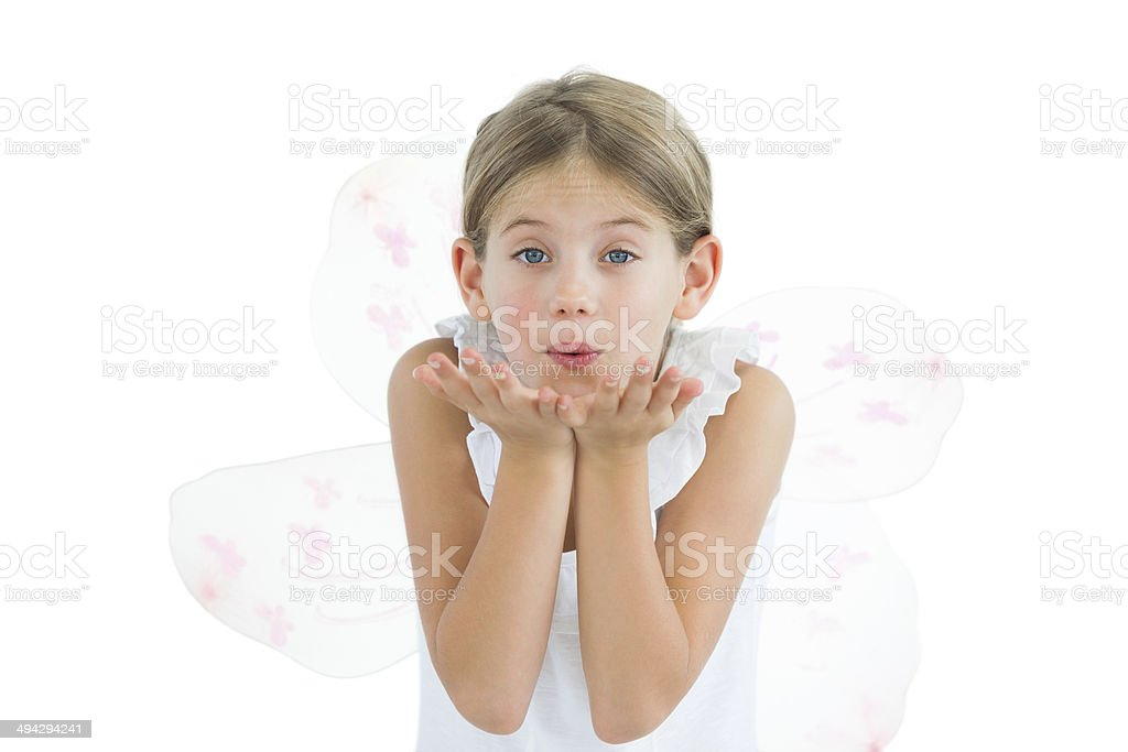 Cute young girl sending kiss to camera stock photo