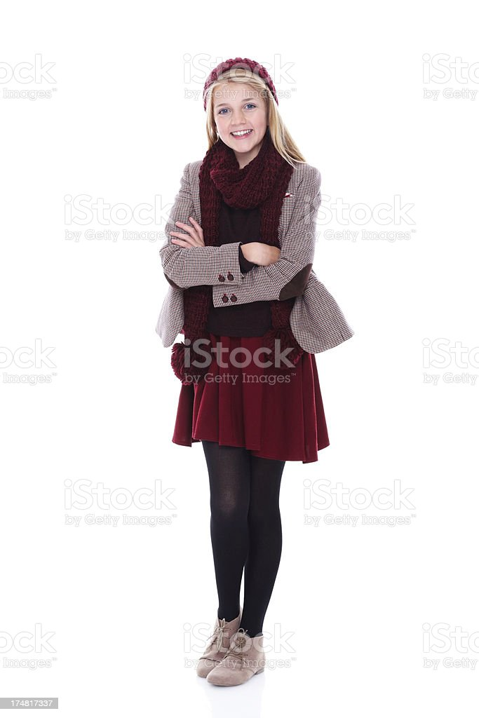 Cute young girl standing on white background royalty-free stock photo
