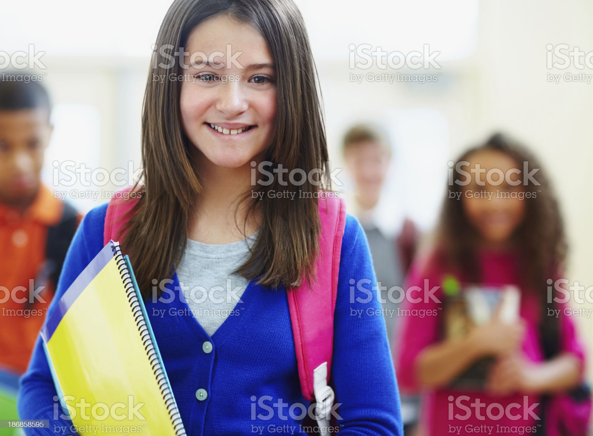 Cute young girl with friends in the background royalty-free stock photo