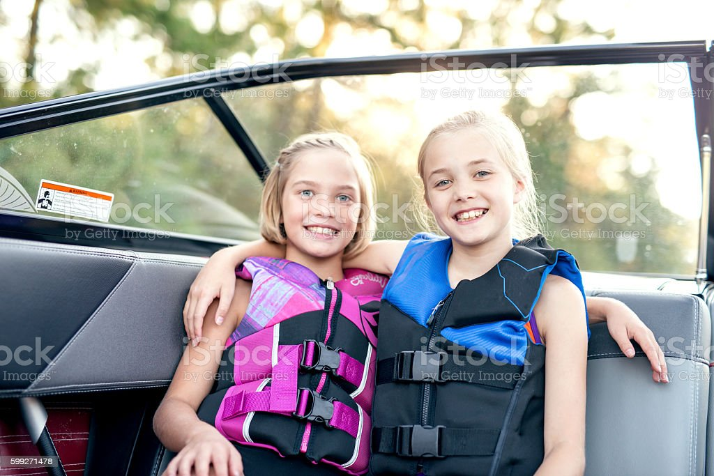 Cute young girls wearing their lifejackets stock photo