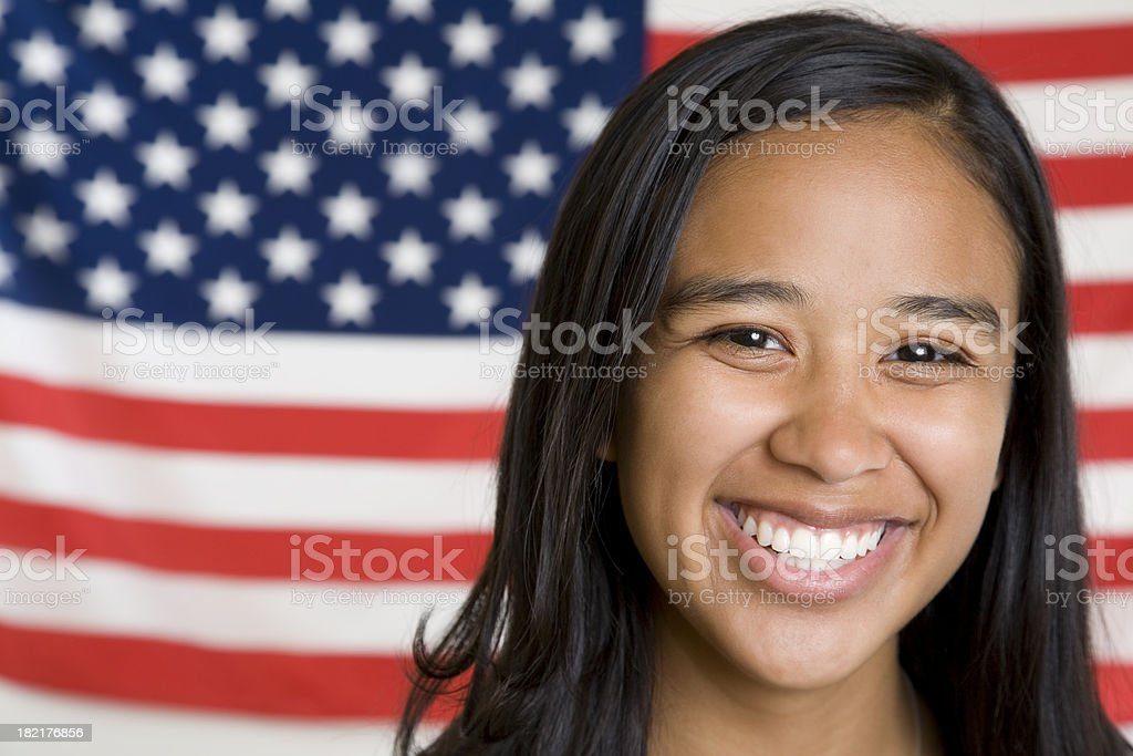 Cute Young Hispanic Girl in Front of American Flag royalty-free stock photo