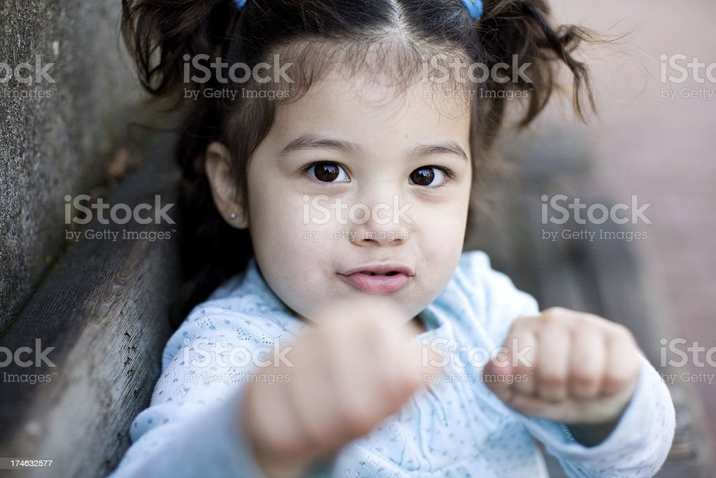 cute young hispanic girl with pigtails boxing stock photo