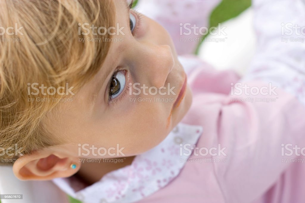 Cute young lady looking up stock photo