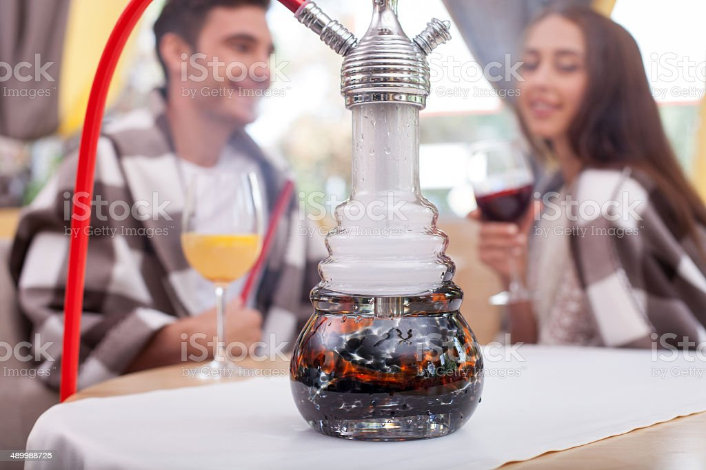 Cute young loving couple is relaxing in cafe stock photo