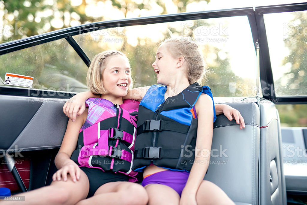 Cute young sisters laughing together stock photo