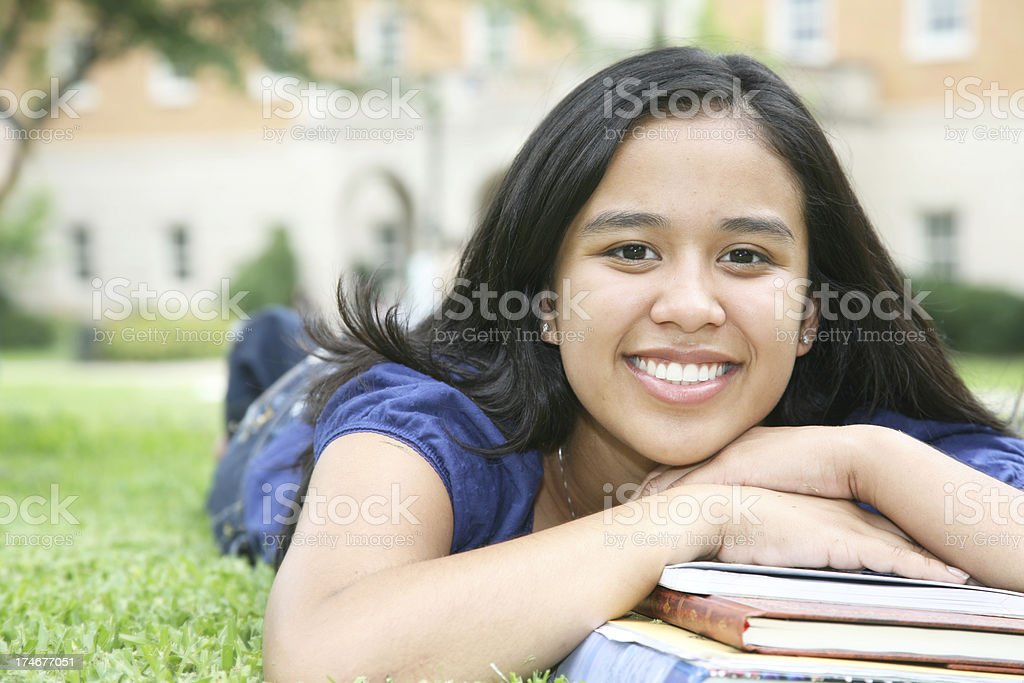 Cute Young Student with Books on Campus Grounds royalty-free stock photo
