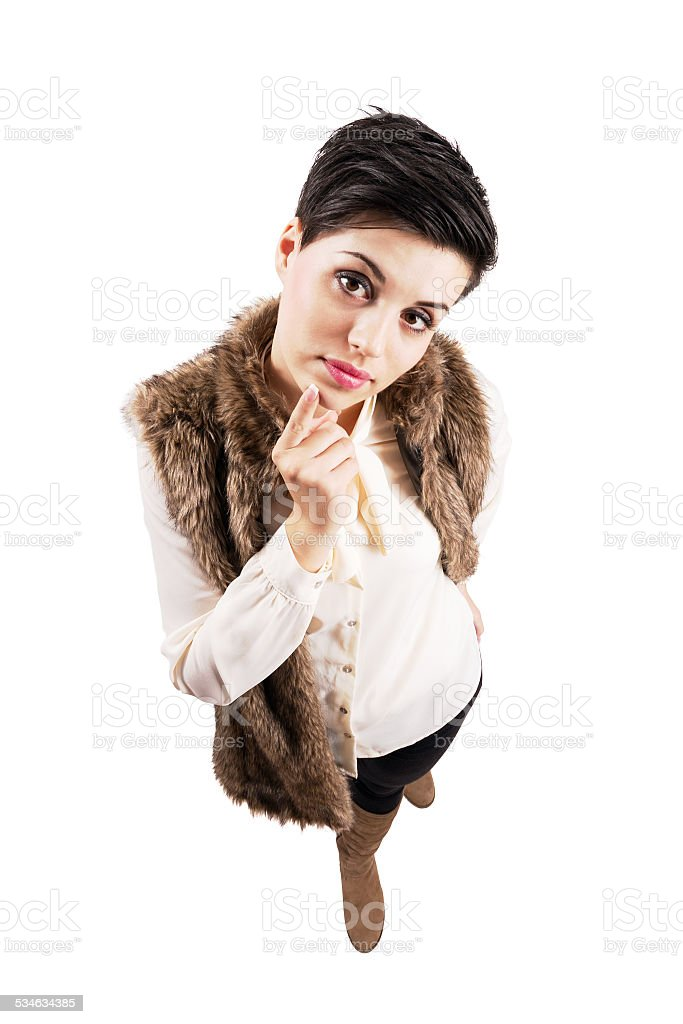 Cute young stylish woman curious looking at camera. stock photo