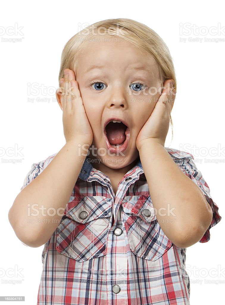 Cute young surprised boy stock photo