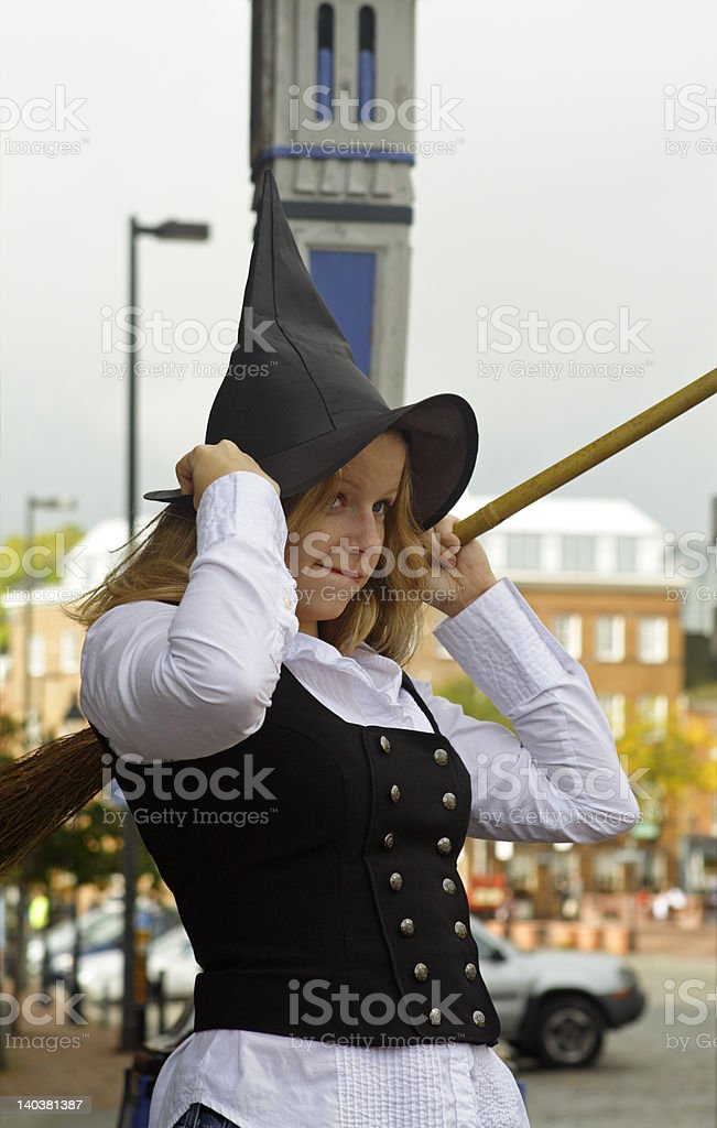 Cute young woman dressed as a witch royalty-free stock photo