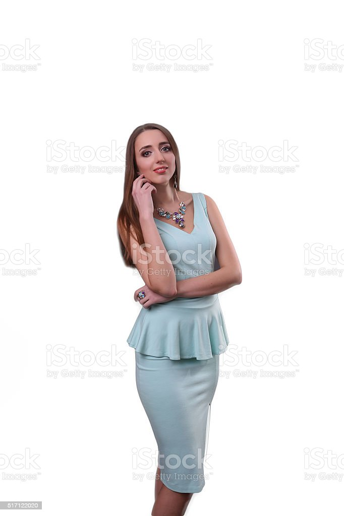 Cute young woman in navy blue dress on white background royalty-free stock photo