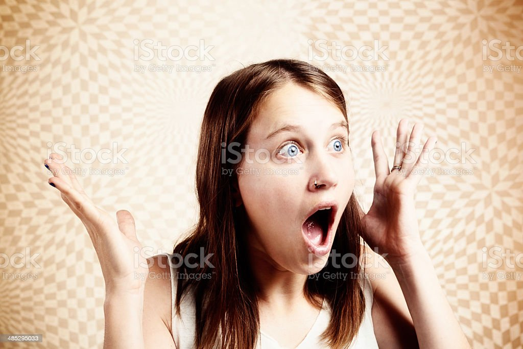 Cute young woman is absolutely, totally amazed! stock photo