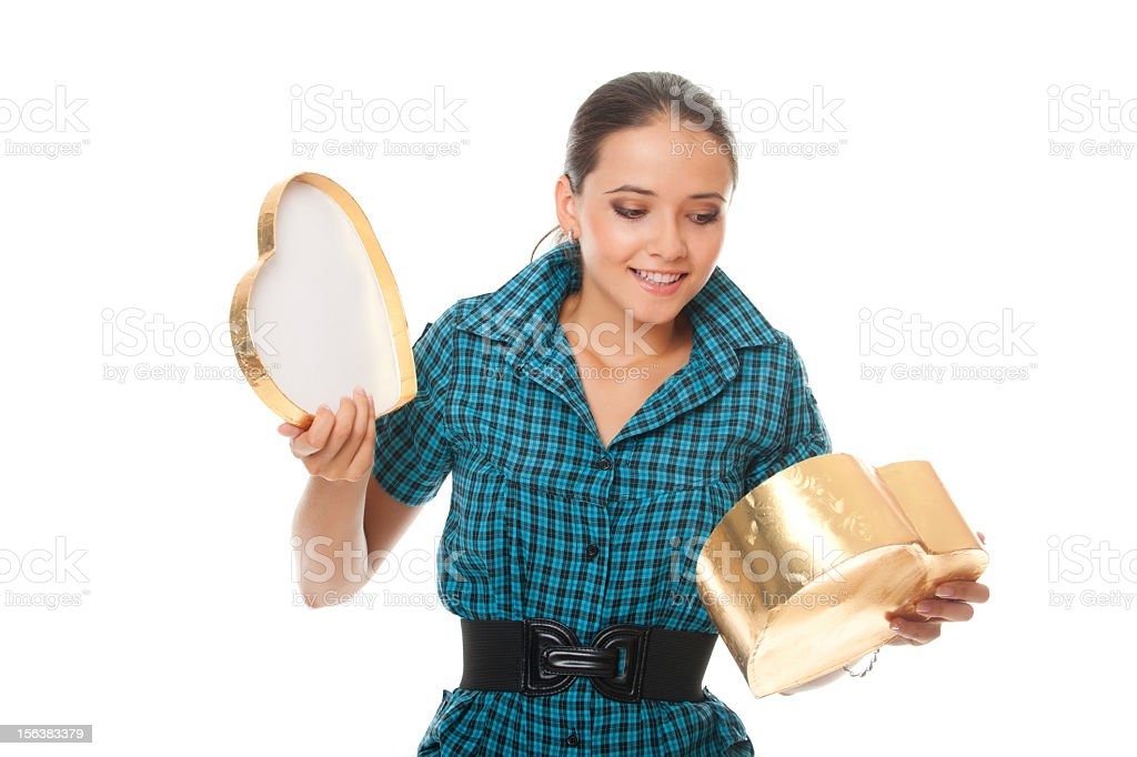 cute young woman looking into gold  box gift as heart royalty-free stock photo