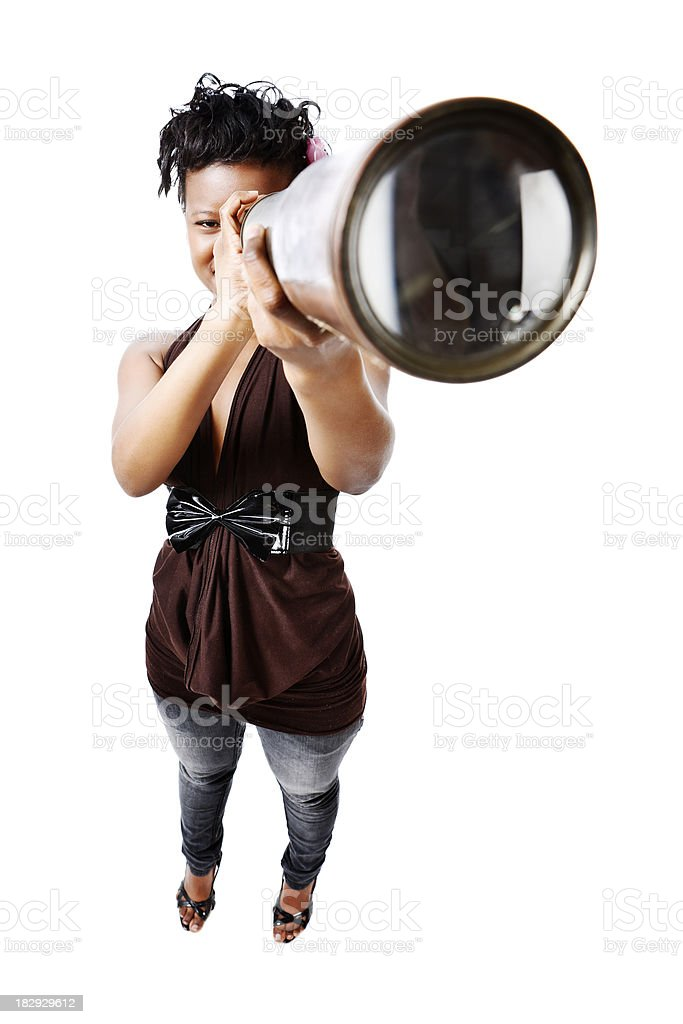 Cute young woman looks to the future through telescope royalty-free stock photo