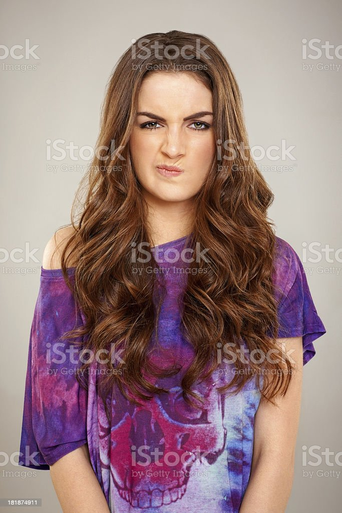 Cute young woman pulling an angry and disgusted face royalty-free stock photo