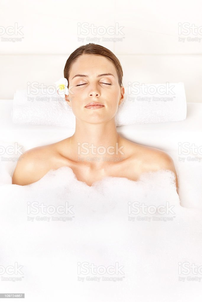 Cute young woman relaxing in bath tub royalty-free stock photo