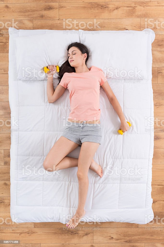 Cute young woman sleeping on bed stock photo