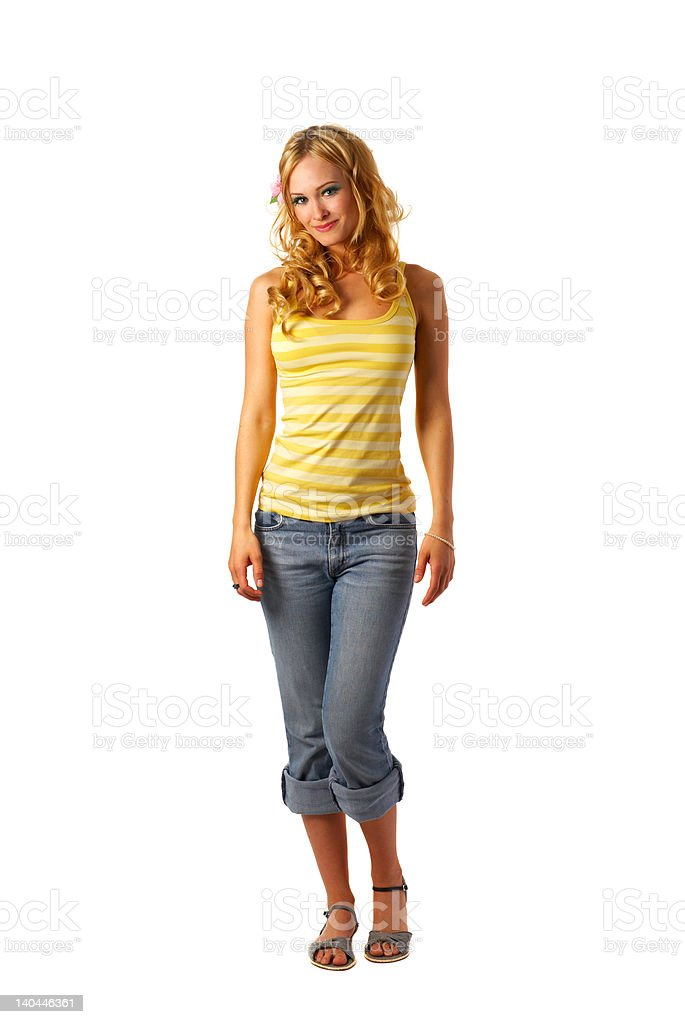 Cute young woman standing against white background royalty-free stock photo