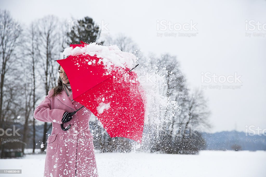 Cute young woman was hit with  snowball royalty-free stock photo