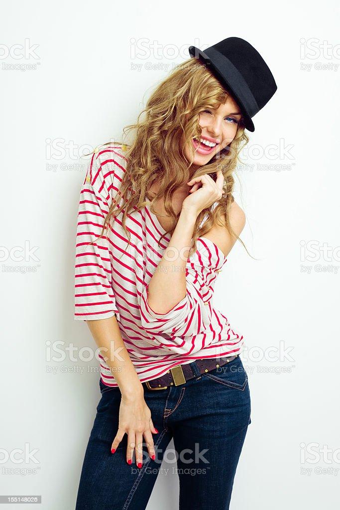 Cute young woman wearing hat stock photo