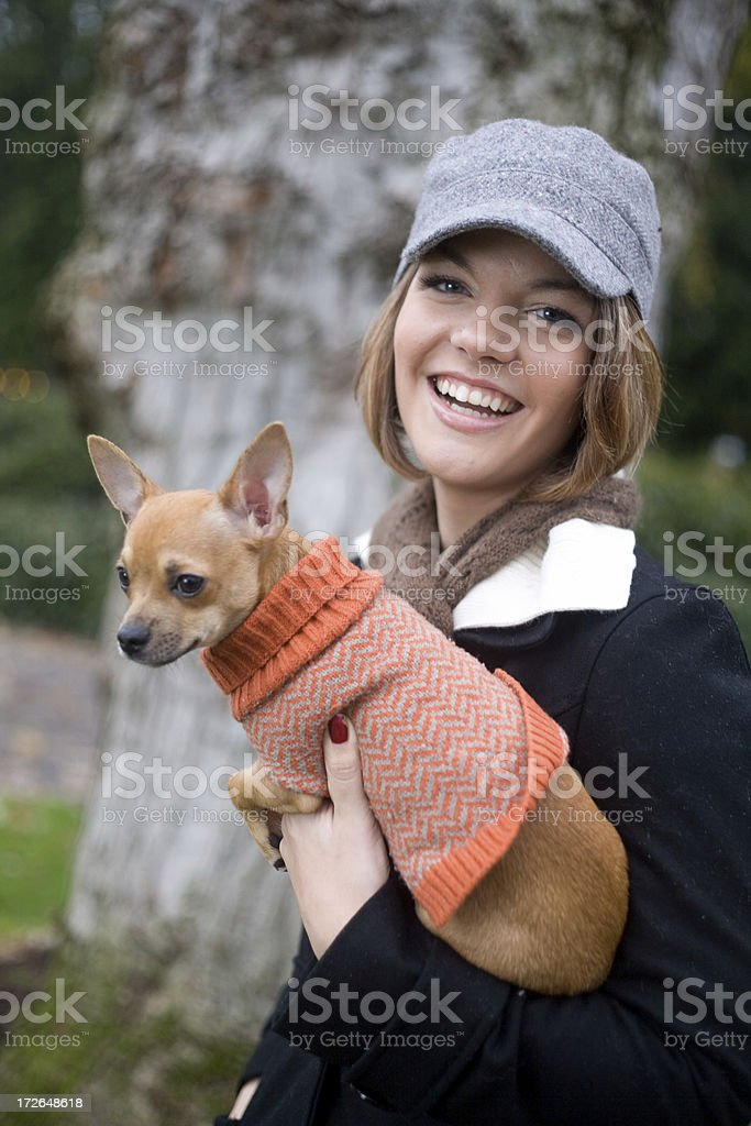 cute young woman with dog royalty-free stock photo