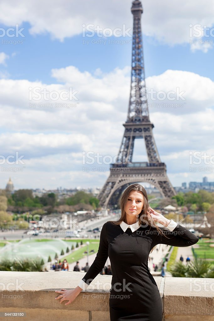 Cute Young Woman's Portrait With Eiffel Tower In The Background stock photo