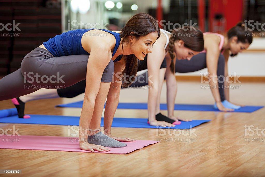 Cute young women doing yoga stock photo