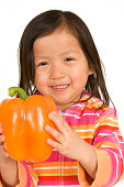 Cutie holding orange bell pepper