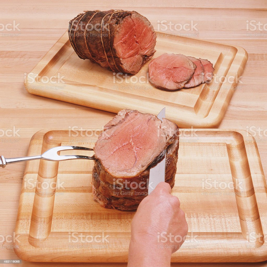 Cuting ham stock photo