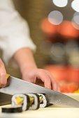 Cuting the sushi roll