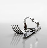 Cutlery, fork with knife and heart