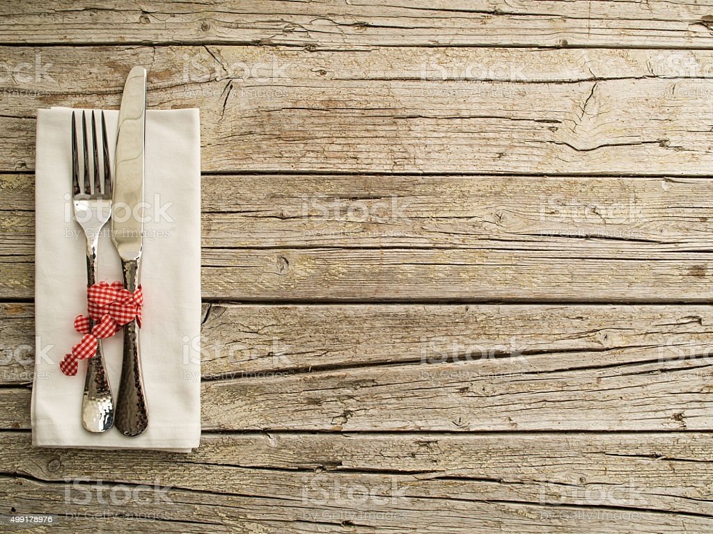 Cutlery kitchenware on old wooden boards background stock photo