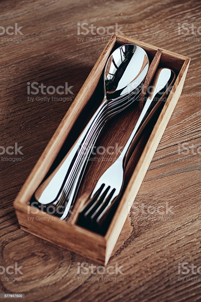 Cutlery pack on wooden surface stock photo