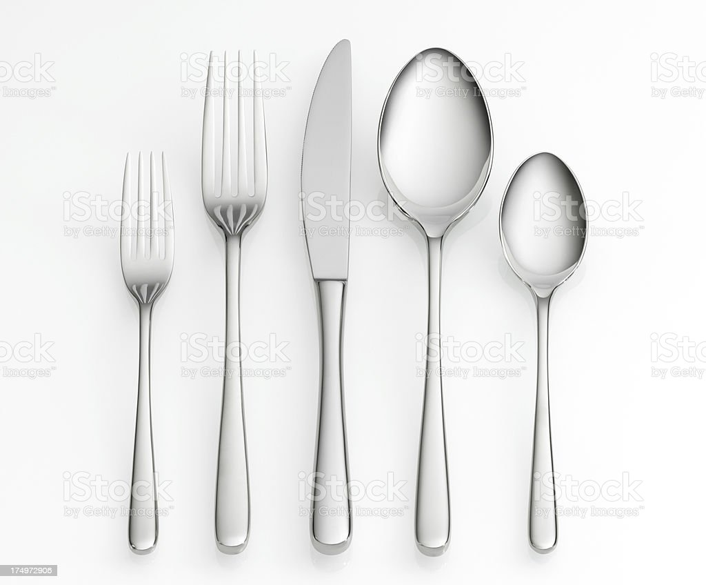 Cutlery set, including knife, forks and spoons stock photo