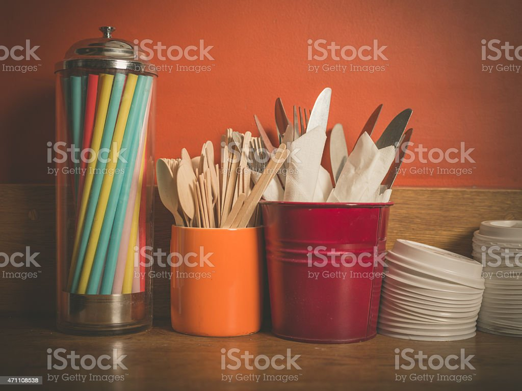 Cutlery straws and plastic lids stock photo