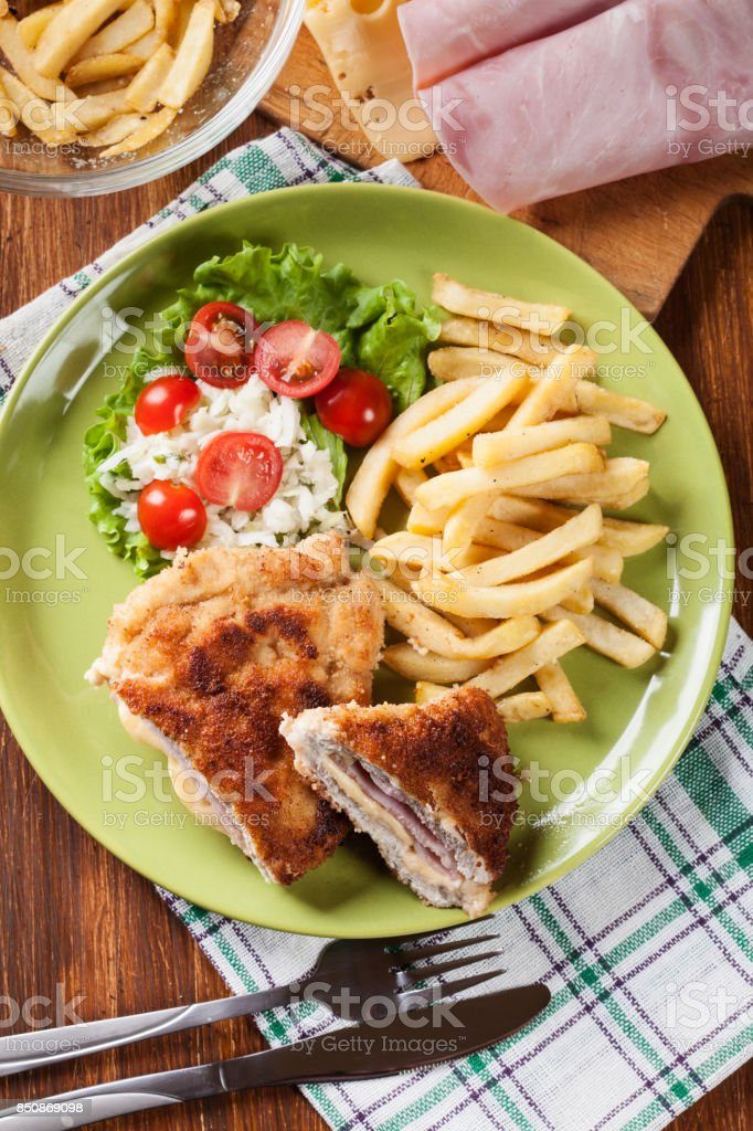 Cutlet Cordon Bleu with pork loin served with French fries and s stock photo