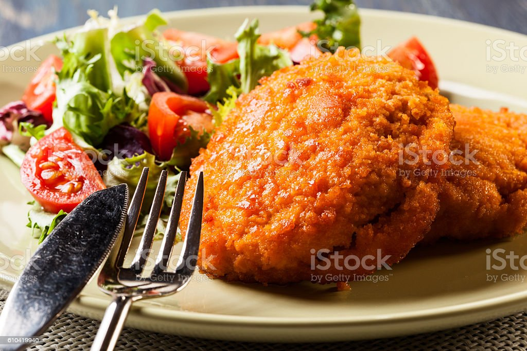 Cutlet Cordon Bleu with salad stock photo