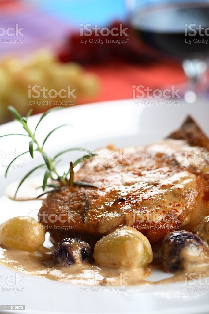 Cutlet with dressing and grapes royalty-free stock photo