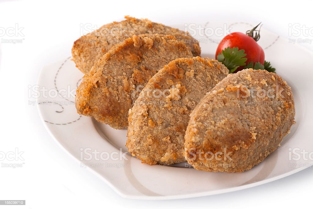 Cutlet with parsley and tomato royalty-free stock photo