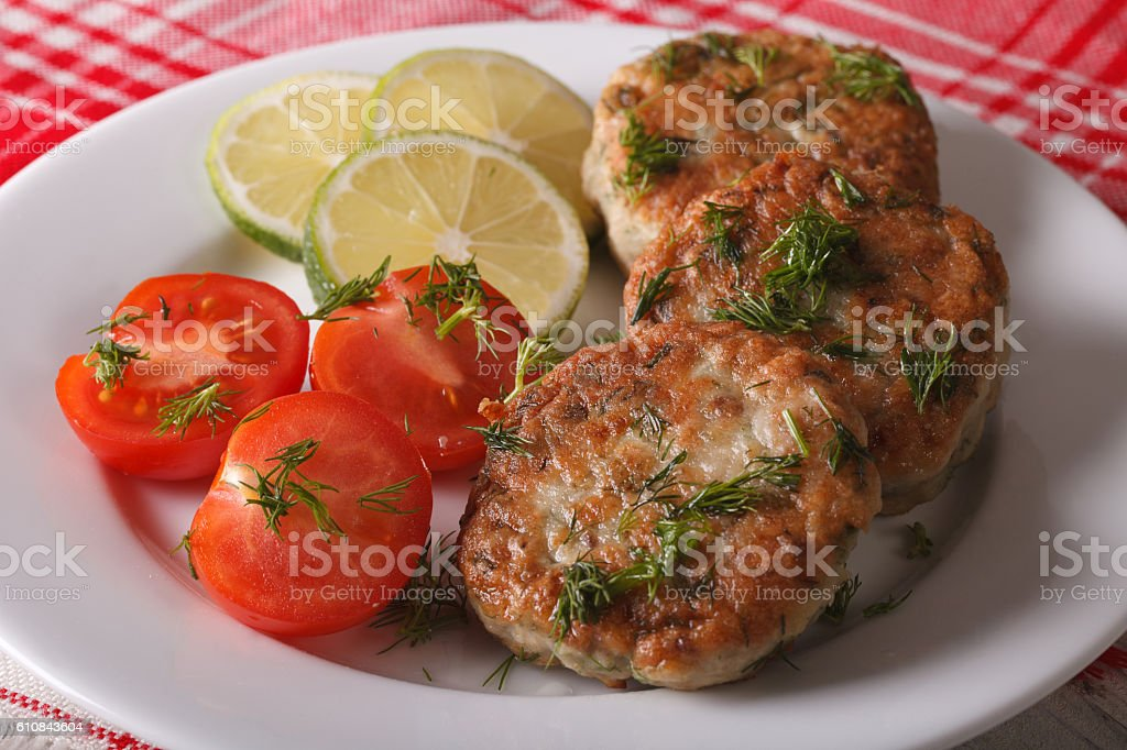 Cutlets from white fish fillets with herbs close-up. horizontal stock photo