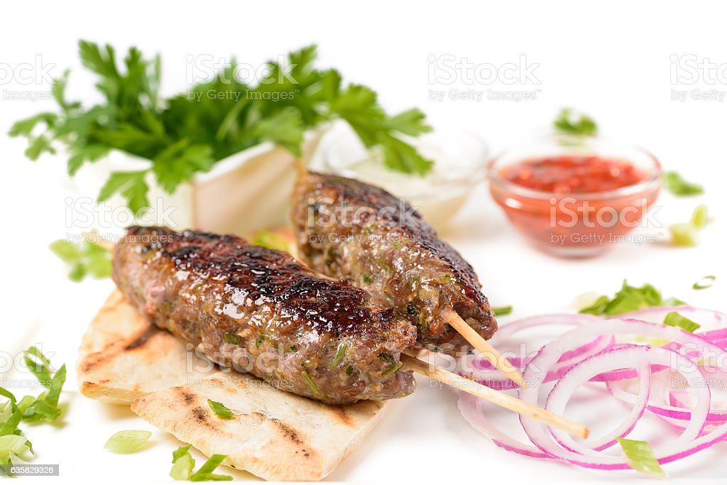 Cutlets on sticks with onions stock photo