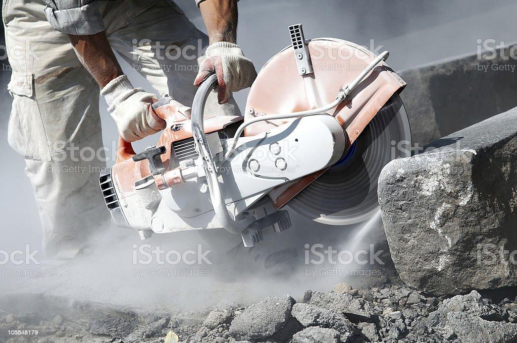 cut-off saw work stock photo