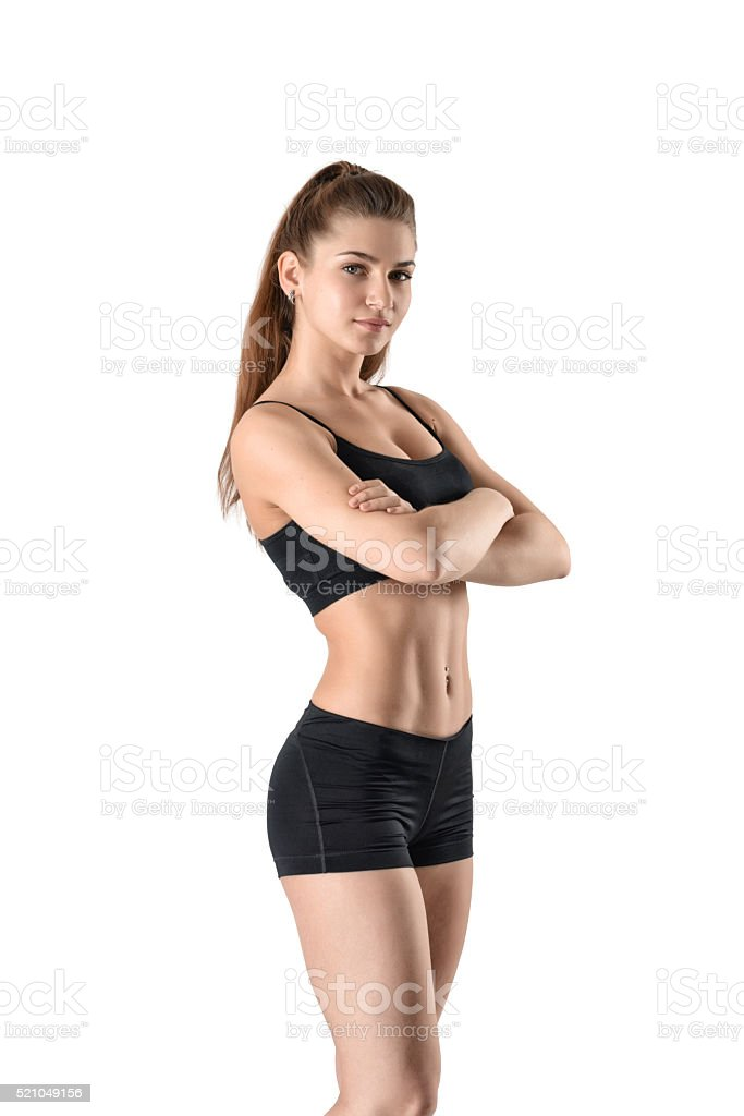 Cutout fitness woman in shorts and a tank top standing stock photo